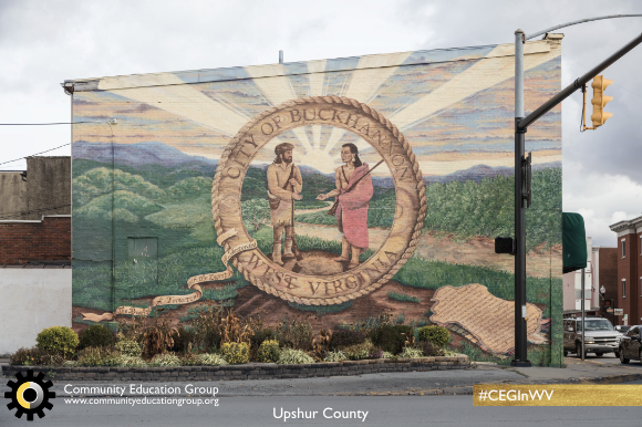 A mural with a mountaineer and a Native American in Upshur County, West Virginia