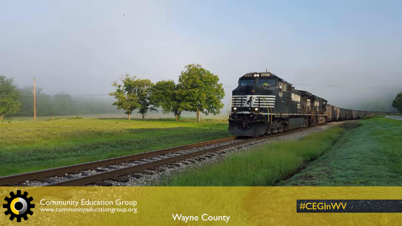 A coal train going through the countryside in Wayne County, West Virginia
