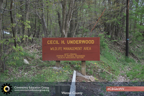 A maroon sign at the entrance of the Cecil H. Underwood Wildlife Management Area in Wetzel County, West Virginia