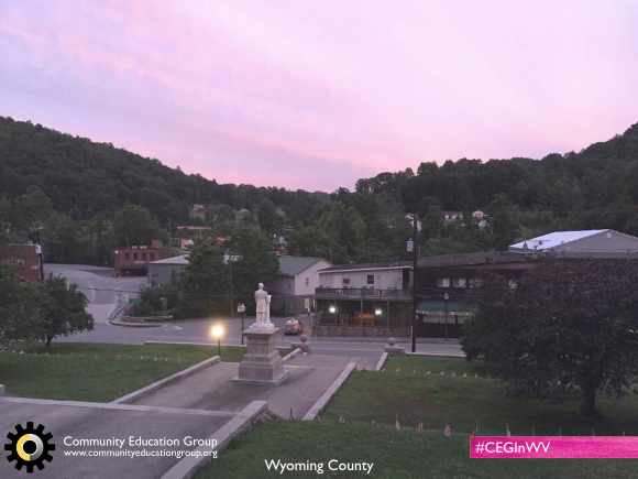 A small town and statue at dusk in Wyoming County, West Virginia